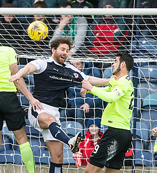 Raith Rovers Craig Barr held by Hibernian's Brian Graham. Raith Rovers 1 v 1 Hibernian, Scottish Championship game played 18/2/2017 at Starks Park.