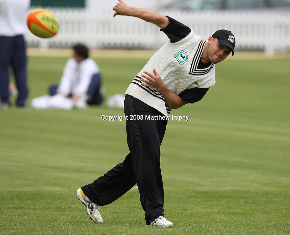 Daniel Flynn passes the rugby ball. New Zealand Cricket Nets, Lord's Cricket Ground, St.Johns Wood, London. 14 May 2008. Photo: Matthew Impey/PHOTOSPORT