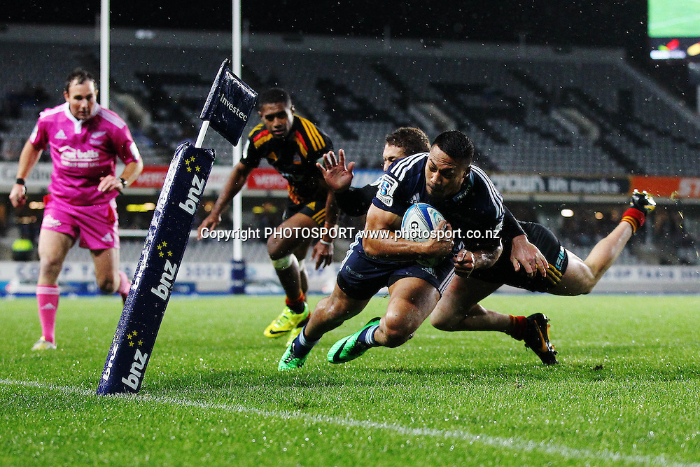 George Moala of the Blues goes in to score a try against Tawera Kerr-Barlow of the Chiefs. Super Rugby rugby union match, Blues v Chiefs at Eden Park, Auckland, New Zealand. Friday 11th July 2014. Photo: Anthony Au-Yeung / photosport.co.nz