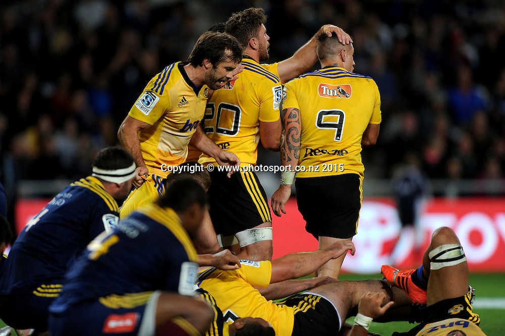The Hurricanes celebrate a try, during the Super Rugby Match between the Highlanders and the Hurricanes, at Forsyth Barr Stadium, Dunedin, New Zealand, 20 March 2015. Credit: Joe Allison / www.photosport.co.nz