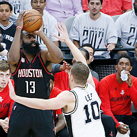 01 May 2017: Houston Rockets guard James Harden (13) takes a jump shot over San Antonio Spurs forward David Lee (10) during the Houston Rockets 126-99 victory over the San Antonio Spurs, in game 1 of the Western Conference Semi Finals, at the AT&T Center, San Antonio, Texas, USA.