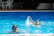 Mother and daughter in a swimming pool at Hotel Silvanetta Palace in Milazzo, Sicily July 2006 Model released