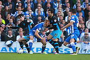 Brighton midfielder Steve Sidwell tussles with Sheffield Wednesday midfielder Kieran Lee & Sheffield Wednesday midfielder Alex Lopez during the Sky Bet Championship play-off second leg match between Brighton and Hove Albion and Sheffield Wednesday at the American Express Community Stadium, Brighton and Hove, England on 16 May 2016. Photo by Bennett Dean.