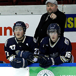 WHITBY, ON - Jan 5 : Ontario Junior Hockey League game action between the Whitby Fury and the Toronto Lakeshore Patriots. Patriots Head Coach give instructions at the bench during second period game action.<br /> (Photo by Tim Bates / OJHL Images)