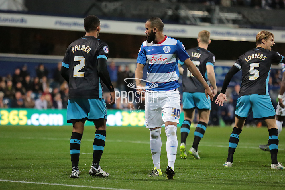 Queens Park Rangers midfielder Sandro and Sheffield Wednesday midfielder Liam Palmer during the Sky Bet Championship match between Queens Park Rangers and Sheffield Wednesday at the Loftus Road Stadium, London, England on 20 October 2015. Photo by Jemma Phillips.