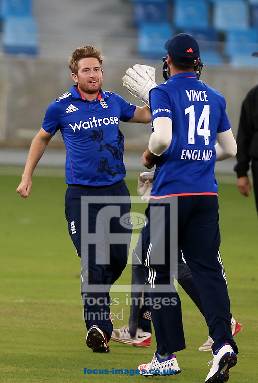 Liam Dawson of England Lions takes the wicket of Babar Azam of Pakistan A during the International Twenty/20 match at Dubai International Cricket Stadium, Dubai<br /> Picture by Chris Whiteoak-Medcalf/Focus Images Ltd +971 8117530<br /> 10/12/2015