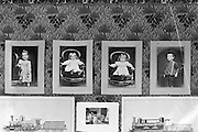 wall with children portraits and architecture drawings of steam trains Paris around 1900