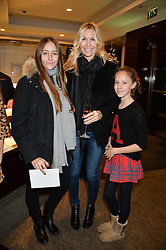 Centre, MELISSA ODABASH and her daughters, left, ALAIA and right AVALON at a VIP evening hosted by Joely Richardson at the Tiffany & Co Christmas Shop, Tiffany & Co Old Bond Street, London on 24th November 2013.