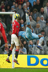 MANCHESTER, ENGLAND - Sunday, January 8, 2012: Manchester City's Micah Richards in action against Manchester United's Chris Smalling during the FA Cup 3rd Round match at the City of Manchester Stadium. (Pic by David Rawcliffe/Propaganda)