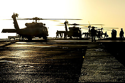 Apr 21, 2017 - Pacific Ocean - MH-60 Seahawk helicopters prepare to take off from the flight deck of the USS Theodore Roosevelt in the Pacific Ocean, April 21, 2017. The aircraft carrier is conducting training off the coast of California. Navy photo by Petty Officer 3rd Class Spencer Roberts. (Credit Image: ? Mass Communication Specialist 3rd Class Spencer Roberts/DoD via ZUMA Wire/ZUMAPRESS.com)