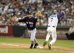 Phoenix, AZ-05-12-04 New York Mets 1st baseman Mike Piazza doesn't get the throw in time to put out Robby Hammock in a 1-0 victory over the Arizona Diamondbacks. Ross Mason photo