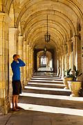 SANTIAGO DE COMPOSTELA, SPAIN - 10th October 2017 - A pilgrim prays at the Praza do Obradoiro main square and Town hall in Santiago de Compostela after walking the Camino de Santiago (Way of St. James), Galicia, Spain.