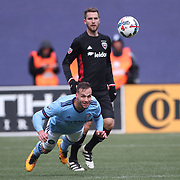 NEW YORK, NEW YORK - March 12:  Alexander Ring #8 of New York City FC heads clear from Patrick Mullins #16 of D.C. United during the NYCFC Vs D.C. United regular season MLS game at Yankee Stadium on March 12, 2017 in New York City. (Photo by Tim Clayton/Corbis via Getty Images)