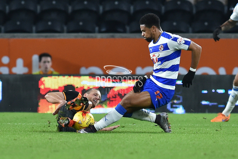 Hull City midfielder David Meyler tries to keep control of the ball under attack from Daniel Williams Reading FC   during the Sky Bet Championship match between Hull City and Reading at the KC Stadium, Kingston upon Hull, England on 16 December 2015. Photo by Ian Lyall.