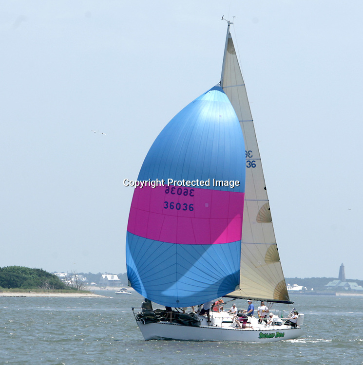 A boat competes in the Cape Fear Yacht Club/State Port Pilot Commodore's Regatta Friday July 4, 2014 in Southport, N.C. (Jason A. Frizzelle)