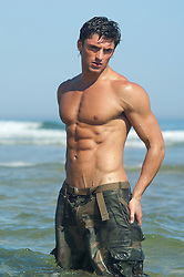 man with a smooth muscular body in the ocean