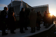 Lawyers wait in line at their entrance at the U.S. Supreme Court in Washington, on the day the court heard arguments in a challenge against California's voter-approved ban on same-sex marriage.