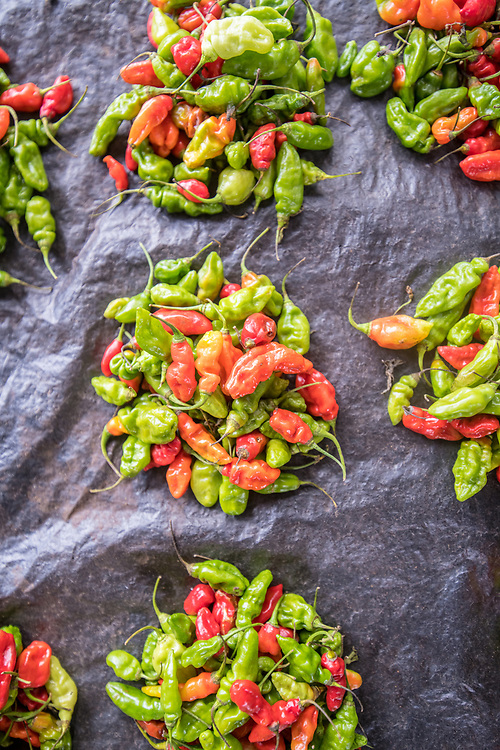 Small red and green peppers pile up in Ganta, Liberia