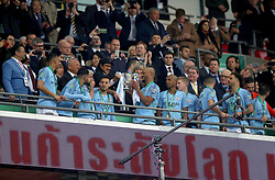 Manchester City's Vincent Kompany (centre) and his team-mates collect the trophy after the Carabao Cup Final at Wembley Stadium, London.