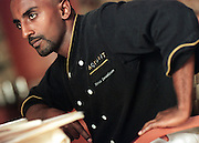Chef Marcus Samuelsson of Aquavit restaurant is seen in July 1999 at the restaurant in Minneapolis. Samuelsson, executive chef of Aquavit in Minneapolis and New York City, was named one of the nation's 100 most eligible bachelors by the editors of People.     Samuelsson was ranked No. 5 on the list, behind actor George Clooney, New York Yankees shortstop Derek Jeter, actor Matt Damon and George Prescott Bush, son of Florida Gov. Jeb Bush. (AP Photo/Star Tribune, Judy Griesedieck)