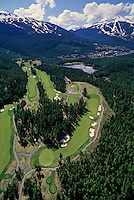 The Chateau Whistler Golf Course weaves above the Whistler Valley, with Blackcomb and Whistler Mountains in the distance.