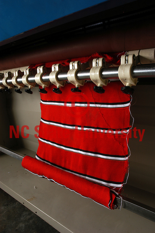 Woven material on equipment in the College of Textiles.   PHOTO BY ROGER WINSTEAD