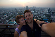 Downtown Bangkok and Chao Phraya River at sunset seen from Banyan Tree Hotel's Vertigo Grill & Moon Bar on the 61st floor. Heimo Aga + Nicole Schmidt.