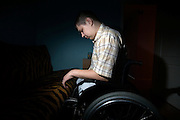 Russian army hazing victim Andrei Sychyov sits on a wheelchair at home in Yekaterinburg..On New Yearís Day in 2006 in the barracks of the Chelyabinsk Tank Academy, a sergeant, possibly drunk, meted out punishment to Pvt. Andrei S. Sychyov..Private Sychyov was forced to squat for three and a half hours. When he complained, as the pain worsened, the sergeant stomped on his ankle twice..Private Sychyov suffered injuries that resulted in infection, then in the amputation of his both legs, a finger, and genitals. .His case became the biggest scandal to reflect the state of Russia's army and the country's human rights situation.