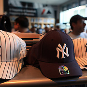 Yankee baseball hats for sale at the Yankees store at Yankee Stadium, The Bronx, during the New York Yankees V Detroit Tigers Baseball game at Yankee Stadium, The Bronx, New York. 28th April 2012. Photo Tim Clayton