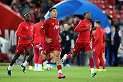 Liverpool forward Sadio Mane (10) Liverpool forward Roberto Firmino (9) and Liverpool midfielder Georginio Wijnaldum (5) warming up during the Champions League match between Liverpool and FC Red Bull at Anfield, Liverpool, England on 2 October 2019.