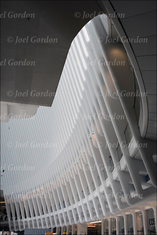 The World Trade Center Transportation Hub is a transit and retail complex.. <br /> <br /> Designed by Spanish architect Santiago Calatrava, the Transportation Hub is composed of a train station with a large and open mezzanine.<br /> <br /> Oculus resembles a bird being released from a child's hand. The roof was originally designed to mechanically open to increase light and ventilation to the enclosed space. <br /> <br /> This mezzanine is connected to an aboveground head house structure, called the Oculus, located between 2 World Trade Center and 3 World Trade Center, as well as public concourses under the various towers in the World Trade Center complex