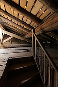empty attic roof space with stairs