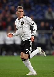 BASTIAN SCHWEINSTEIGER.GERMANY.GERMANY V IVORY COAST.VELTINS ARENA, GELSENKIRCHEN, GERMANY.18 November 2009.GAB4640..  .WARNING! This Photograph May Only Be Used For Newspaper And/Or Magazine Editorial Purposes..May Not Be Used For, Internet/Online Usage Nor For Publications Involving 1 player, 1 Club Or 1 Competition,.Without Written Authorisation From Football DataCo Ltd..For Any Queries, Please Contact Football DataCo Ltd on +44 (0) 207 864 9121
