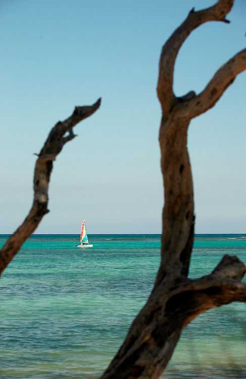 Punta Cana, Dominican Republic - April 11: A sailboat cruises on calm waters near Punta Cana Beach, in the Dominican Republic, April 11, 2007..