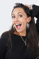 Portrait of surprised happy young woman over white background