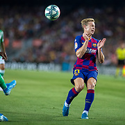 BARCELONA, SPAIN - August 25:  Frenkie de Jong #21 of Barcelona takes evasive action from a clearance during the Barcelona V  Real Betis, La Liga regular season match at  Estadio Camp Nou on August 25th 2019 in Barcelona, Spain. (Photo by Tim Clayton/Corbis via Getty Images)