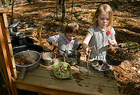 "Devin Turcotte and Willow Clark-Patten in the ""kitchen area"" making some lunch at Prescott Farm's Natural Playscape following their grand opening on Saturday morning.  (Karen Bobotas/for the Laconia Daily Sun)"