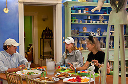 Ben and Deb Johns eat dinner with their daughter Gussie inside their home in Washington, D.C., Sept. 16, 2011.