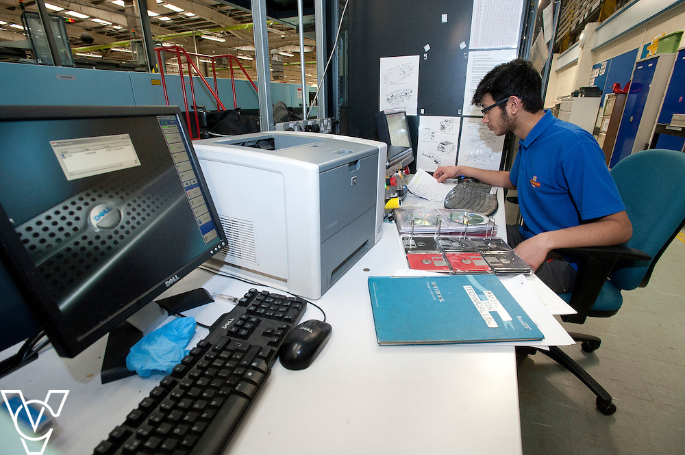 Royal Mail - Preston Mail Centre: <br /> <br /> Pictured is Adam Desai carrying out some preventative maintenance on a machine <br /> <br /> Date: March 16, 2015