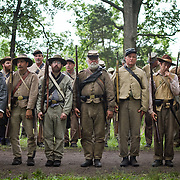 Confederate living historians line up prior to an artillery and skirmish demonstration, during the Sesquicentennial Anniversary of the Battle of Gettysburg, Pennsylvania on Wednesday, July 3, 2013.  The Battle of Gettysburg lasted from July 1-3, 1863 resulting in over 50,000 soldiers killed, wounded or missing.  John Boal Photography