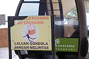 Panorama Langkawi. The SkyCab cable car. Warning sign.