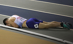 Great Britain's Guy Learmonth (right) after crashing out of the men's 800m semi final during day two of the European Indoor Athletics Championships at the Emirates Arena, Glasgow.