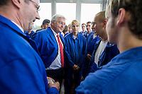 29 AUG 2008, EISENHUETTENSTADT/GERMANY:<br /> Frank-Walter Steinmeier (2.v.L.), SPD, Bundesaussenminister, und Matthias Platzeck (L), SPD, Ministerpraesident Brandenburg, im Gespraech mit Auszubildenden, waehrend dem Besuch des Stahlwerks ArcelorMittal Eisenhuettenstadt, der ehem. Eko Stahl, im Rahmen von Steinmeiers Sommerreise durch Brandenburg<br /> IMAGE: 20080829-01-033<br /> KEYWORDS: Eisenhüttenstadt, Blaumann