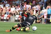 Alex Addai and Dannie Bulman during the EFL Sky Bet League 2 match between Cheltenham Town and Crawley Town at LCI Rail Stadium, Cheltenham, England on 4 August 2018. Picture by Antony Thompson.
