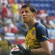 Arsenal goalkeeper Wojciech Szczesny during a downpour while warming up before the New York Red Bulls Vs Arsenal FC,  friendly football match for the New York Cup at Red Bull Arena, Harrison, New Jersey. USA. 26h July 2014. Photo Tim Clayton