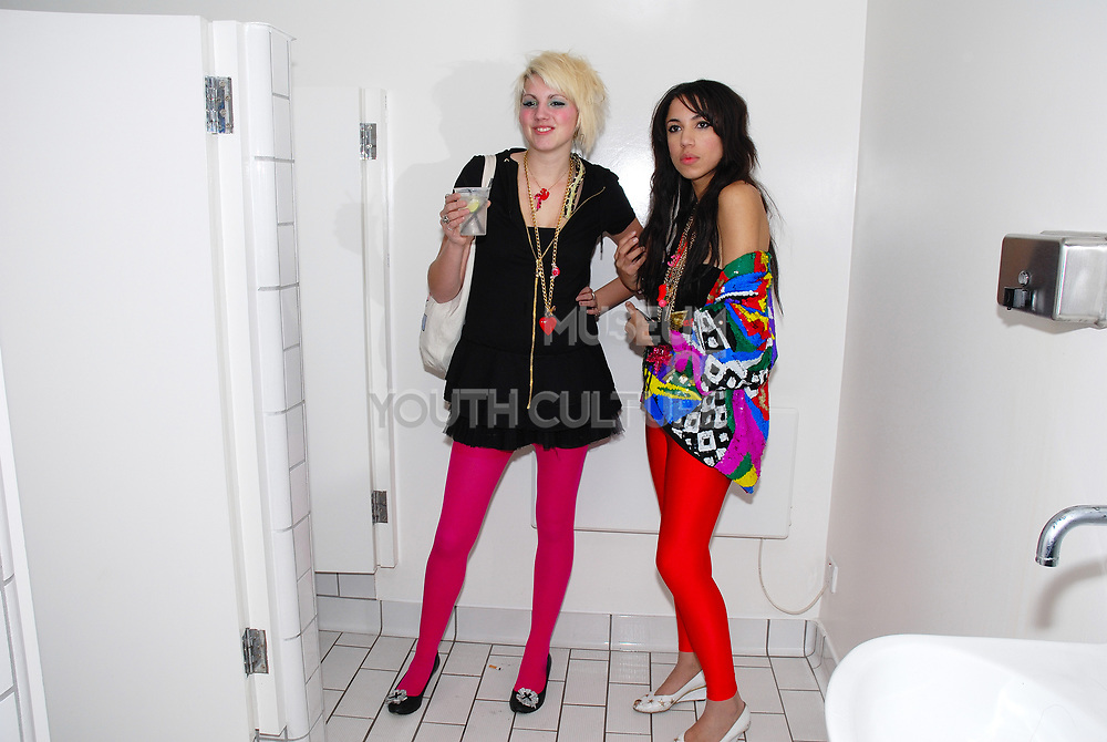 Two girls wearing New Rave styles, in the toilets, Anti-Social, London December 2006