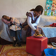 Atlanta, Georgia/Central Africa Republic Refugee/Nestorine Lakas, 27, feeds her son Eric who has cerebral palsy, at their apartment in Atlanta. Nestorine arrived in the U.S. in 2010 with her two young children from the Central African Republic. Her son, who is now 7-years-old, suffers from severe cerebral palsy and requires a wheelchair and specialized healthcare. At the IRC in Atlanta, Nestorine is part of the Temporary Assistance for Needy Families (TANF) program where she is learning English, job skills and basic computer literacy so she can support her family as a single mom and learn how to manage her son's health needs. Unfortunately the father of Nestorine's children was not able to come to the U.S. with her, so she cares for her children and dreams of reuniting with him someday. Nestorine believes what makes her successful is &quot;working hard and overcoming challenges.&quot;<br />