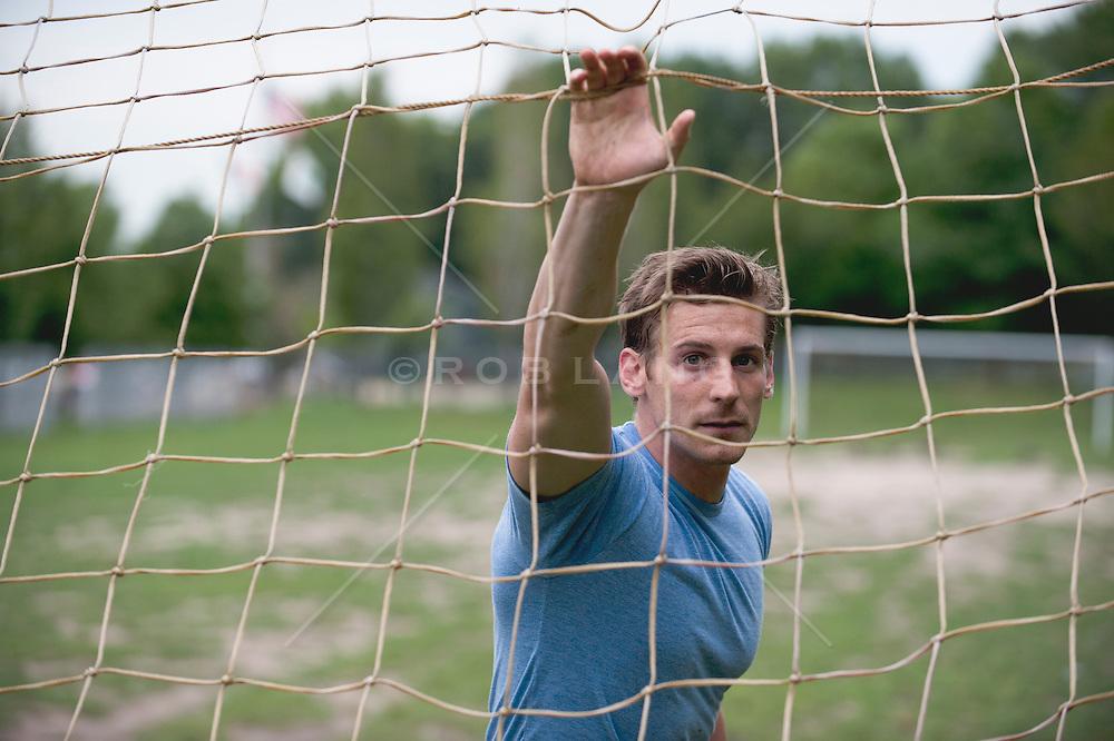 man behind a soccer net