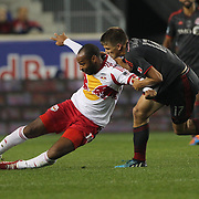 Thierry Henry, (left), New York Red Bulls, is fouled by Nick Hagglund , Toronto FC, during the New York Red Bulls Vs Toronto FC, Major League Soccer regular season match at Red Bull Arena, Harrison, New Jersey. USA. 11th October 2014. Photo Tim Clayton