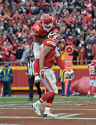 Dec 27, 2015; Kansas City, MO, USA; Kansas City Chiefs tight end Travis Kelce (87) is congratulated by running back Charcandrick West (35) after scoring during the first half against the Cleveland Browns at Arrowhead Stadium. Mandatory Credit: Denny Medley-USA TODAY Sports